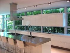 Awesome kitchen! I love high-gloss lacquered white cabinetry.