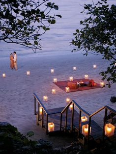 Candles, sand, a blanket and a sunset are a recipe for romance