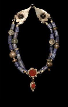 Precolombian sodalite beads, Persian amulets, Turkman silver beads.