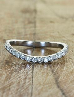 Curved wedding band to fit engagement ring and still make sense and look lovely with out engagement ring