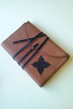 DIARIO IN VERA PELLE CON LACCIO ----------NOTEBOOK IN LEATHER WITH THONG---- MADE in ITALY ----Design ----Email: pietrobiccheri@gmail.com