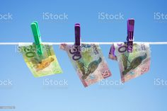 New Zealand (NZD) Money Laundering Concept New Zealand Dollars (NZD) on a Washing Line for a Money Laundering Concept. Backgrounds Stock Photo Image Now, New Image, Bank Financial, New Zealand Dollar, Money Laundering, Photo Illustration, Royalty Free Images, Backgrounds, Concept