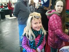 Two very different reactions to a friendly lizard at the Pet Expo.  Too funny!  @Cara Blanchette
