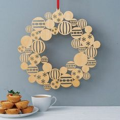 We love this gorgeous laser cut Christmas wreath. Great idea!