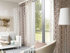 Two different colors of ADO fabric design 3308 are layered and puddled to add pattern and texture to this modern decor.