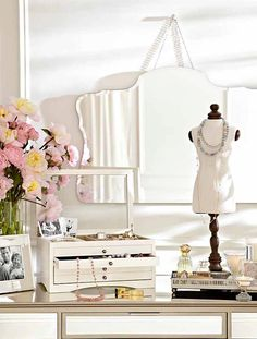 5 great tips for accessorizing your dresser: 1. Hang a mirror to reflect natural light. 2. Use a decorative tray to display your favorite perfume 3. Choose a glass top jewelry box to showcase beautiful gems 4. Add a framed photo of a special moment to personalize the space 5. Snip fresh flowers from the garden