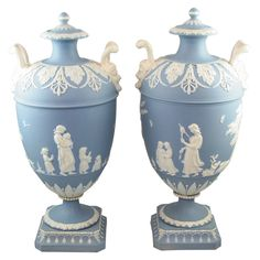 """Pair of Wedgwood Blue & White Jasper Vases  England  circa 1790  A rare pair of Wedgwood blue and white jasper two handled covered vases decorated in relief with """"Lady Templetown"""" designs, upper case marks"""