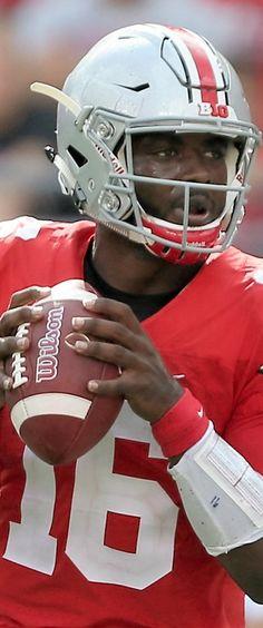 Ohio State Buckeyes quarterback J.T. Barrett (16) drops back to pass against Tulsa, Saturday
