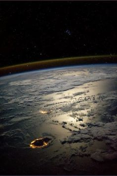The Seven Sisters, also known as the Pleiades star cluster, looking over Reunion & Mauritius Islands in a moonlit Indian Ocean captured by NASA astronaut Karen Nyberg from the International Space Station 19:57 GMT 25 August 2013.