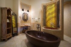 Our bronze finish Adoni Bathtub in the gorgeous Della Terra Mountain Chateau  #TandLbathtubs