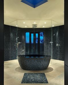 What's not to like w/ this Jaw-dropping tub that was carved from one piece of black granite. (The massive piece had to be brought into the area before the house was even framed.)
