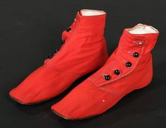 A pair of chisel-toed scarlet wool ankle boots, circa 1850, with black glass and brass side buttons, flat, straight soles, 'Miss Davis'...