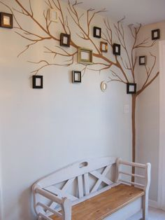 Such a cute way to display famil photos! would be great in a child's room
