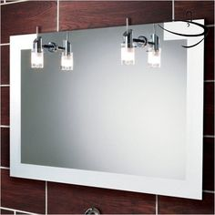 Super sexy bathroom mirror with lights, hanging lights at that! Mirror With Lights, Bathroom Makeover, Bathroom Mirror, Illuminated Mirrors, Bathroom Mirror Lights, Mirror, Bathroom Lighting, Bathroom Chandelier, Bathroom Design
