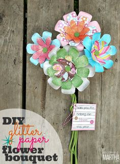 Flowers made from 12 paper strips using paper punch by ek success create easy glitter flower bouquets that never die with this innovation new tool mightylinksfo