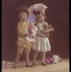 Old Real photo Postcard EDWARDIAN CHILDREN w/ANTIQUE articulated TEDDY BEAR