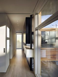 Modern Elegant House Design With Beautiful Garden: Long Alleyway In The Split  Level House With Wooden Floor And White Ceiling Near Glass Wal.