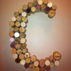 Lots of corks, a cardboard backing, and a glue gun.  Pretty easy.