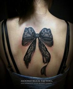 Lace bow tattoo... maybe this one at the top of each thigh.... just smaller