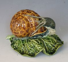A rare and charming Portuguese Palissy ware toothpick stand in the form of a snail atop a lettuce leaf. Indistinct mark, prob Pinheiro. C 1880  Dimensions in Inches: L: 5 ins H: 3.5 ins W: 4 ins