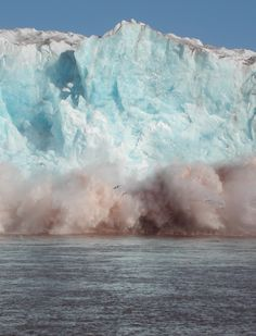 A Glacier. Huge ice walls falling down with a thunder.