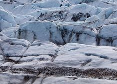 Does this photo make anyone else feel uneasy? I love glaciers, hiking alongside them, on them in Winter (and getting married at the bottom of them, as you do). But the thought of ice climbing fills me with dread. Specifically looking down into deep  crevasses, eek.  This is #Svínafellsjökull, an outlet glacier of #Vatnajökull in Iceland. It's easily accessible and the vantage point from the trail gives you a good sense of scale as to how gigantic those pieces of ice are.  #iceland #glacier Ice Climbing, Arctic Circle, Travel Guides, Adventure Travel, Getting Married, Iceland Glacier, Places To Go, Trail, Hiking