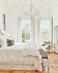 23 European and French Farmhouse Decor Ideas to Inspire - Hello Lovely French Farmhouse Bedroom with shiplap ceiling, shutters, chandelier, and rustic wood floors French Farmhouse Decor, Modern Farmhouse Bedroom, French Country Bedrooms, French Country House, Country Living, Fresh Farmhouse, Bedroom Rustic, Country Style, Bedroom Country