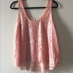 Madewell Sequin Swing Tank Blush colored sequin swing top. The sequins are understated enough for day and transitions great into night. Slightly longer in back than front, length is slightly cropped. Runs on the smaller side, fully lined. Madewell Tops Tank Tops