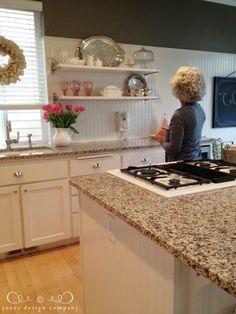 White beadboard backsplash, Ikea shelves, pretty glasses, silver tray