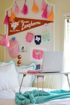 the cutest sorority room ever! {love that flip out lap desk}
