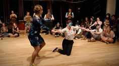 Swing dancers compete in a blindfolded Jack & Jill contest where they are assigned random partners during the Cat's Corner 16th anniversary celebration in Mo...