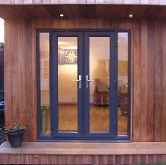 Single pane French doors with narrow windows either side
