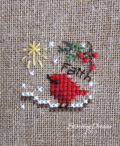 "From the 2013 Just Cross Stitch Ornament issue and is called ""Baby Cardinal"" by The Victoria Sampler. -- So sweet."