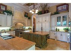 Kitchen - white glazed cabinets - green center island.  Grey Oaks in Naples, FL