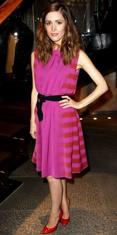 Rose Byrne in Bottega Veneta- red and fuschia striped dress with black sash and red shoes.