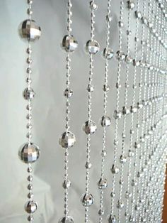Go retro with this silver Disco Ball beaded cut curtain. With the intricate bead work, this 3ft wide x 6ft long curtain is perfect for any space that needs some drama. Mounted on a rod with clips t...