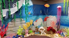 Underwater scene. Cardboard props and pool noodle coral.