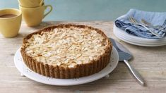 Make a change from the usual Christmas desserts with this tart made from pears poached in spice and wine, pressed into frangipane. Equipment and preparation: You will need a fluted loose bottom tart tin and a piping bag. Bakewell Tart, Tart Recipes, Baking Recipes, Dessert Recipes, Pastry Recipes, Baking Ideas, Dessert Ideas, Sweet Recipes, Frangipane Tart