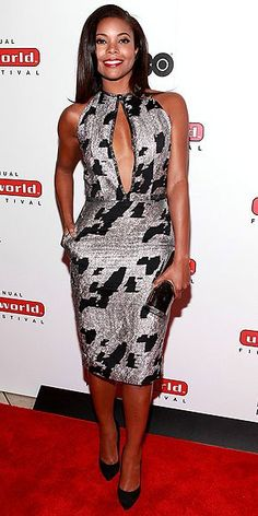 Gabrielle Union looks absolutely stunning in this abstract black and whit print dress at the Urban World. The deep V in the front with her bold red lip takes this dress to the top and I think defin…