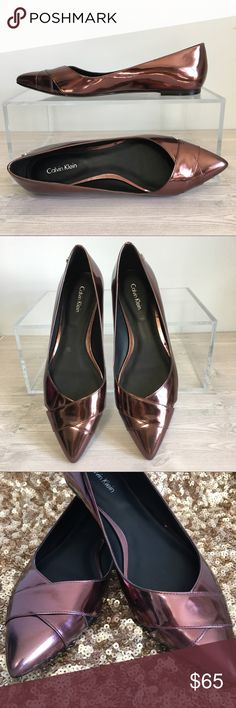 """Calvin Klein Gailia Ruby Bronze Metallic Flats 8.5 Want a sexy little pop of Metallic color?  Gorgeous Calvin Klein Gailia Metallic Flats.  Unique color Ruby Bronze.  Patent Leather. Pointy toes with a criss cross detail across the top of the toes.  Notice the peekaboo openings on each side of the shoes. Rubber soles for comfy wear.  Heal height .25"""".   Brand New, without box.  Size 8.5 Calvin Klein Shoes Flats & Loafers"""