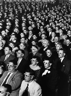 Riveted audience members enjoy opening night of the first full-length American 3-D feature film: the Arch Oboler-directed drama, Bwana Devil. 1952.