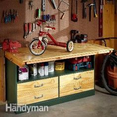 Garage Workbench This simple garage workbench folds out to make a spacious benchtop and folds back down to make more room for your car.
