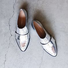 Loeffler Randall Silver Pleated Loafers SOLD OUT EVERYWHERE. A classic loafer from Loeffler Randall with a bright, mirror finished leather. Featuring a pleated elastic panel + low stacked heel for easy slip-on & comfort.   Content & Care - Leather, mixed materials - Spot clean - Made in Brazil  Size - Fits like a 5.9, will stretch out with wear  NOTE: Store display, Silver upper has 2 light, unnoticeable scuffs, easily repairable. NEW WITH NORDSTROM STICKER TAG, NO BOX  Photo's 3,4…