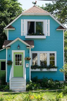 tiny house in blue with white & green accents cute garden shed color scheme.