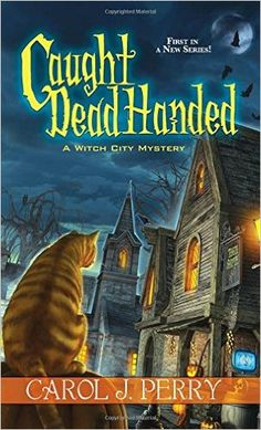 Amazon.com: Caught Dead Handed (A Witch City Mystery) (9781617733697): Carol J. Perry: Books
