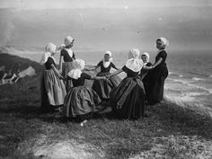 A group of young Dutch girls play on a cliff overlooking the ocean in the early 1900s Photograph: Chusseau-Flaviens/ George Eastman House/ Getty Images