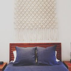 love the hung rug/throw as texture behind bed