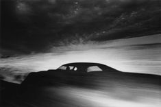 ikko narahara 1971:  shadow of a car driving through desert, arizona