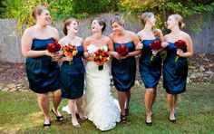 These midnight blue satin dresses look great on all of her Bridesmaids!