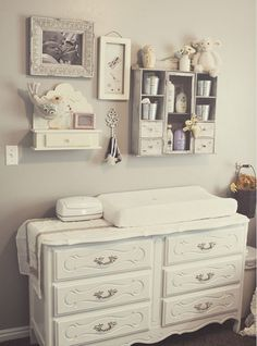 I am so obsessed with this collage above the dresser with a changing pad <3